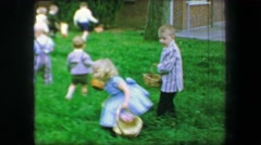 1967: Easter egg hunt in long green thick grass in Sunday's best clothing. - stock footage