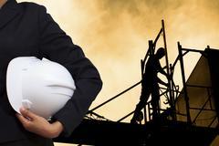 engineer holding white helmet - stock photo