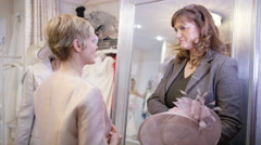 4K Mother & grandmother of the bride trying on outfits in bridal store - stock footage