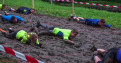 Teams are crawling across the mud pool very quickly Stock Footage