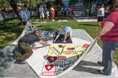TUCSON, AZ/USA - OCTOBER 12, 2014:  Unidentifed people at AIDS Quilt Ceremony - stock photo