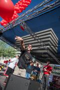 TUCSON, AZ/USA - OCTOBER 12, 2014: man releases red baloon for AIDSwalk  Stock Photos