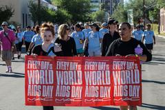 TUCSON, AZ/USA-OCTOBER 12, 2014: Walker s with World AIDS Day sign at AIDSwalk - stock photo