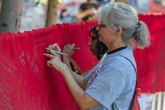 TUCSON, AZ/USA - OCTOBER 12, 2014:  Unidentified people writing on memorial AIDS Stock Photos