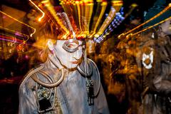 TUCSON, AZ/USA - NOVEMBER 09, 2014: Effect shot of performer at the All Souls Pr - stock photo