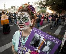 TUCSON, AZ/USA - NOVEMBER 09, 2014: woman with memorial sign in facepaint at the - stock photo