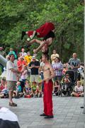 DES MOINES, IA /USA - AUGUST 10, 2014 : Red Trouser Show acrobats David Graham,  - stock photo