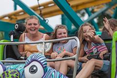 DES MOINES, IA /USA - AUGUST 10,2014: girls enjoy a carnival ride at Iowa State  Stock Photos