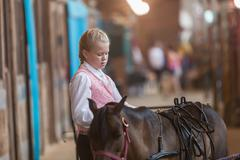DES MOINES, IA /USA - AUGUST 10,2014: girls with horse at Iowa State fair - stock photo