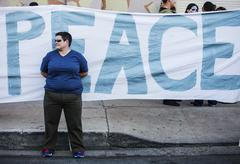 TUCSON, AZ/USA - NOVEMBER 09,2014: woman in front of peace banner at the All Sou - stock photo