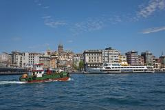 Bosphorus Activity with Galata Neighborhood in the Background - stock photo