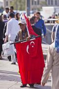 Street Vendor Near Istanbul Spice Market with Turkish Flags Stock Photos