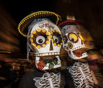 TUCSON, AZ/USA - NOVEMBER 09,2014: Two people in large masks in the All Souls Pr - stock photo