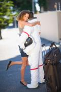 Woman embracing an astronaut Stock Photos