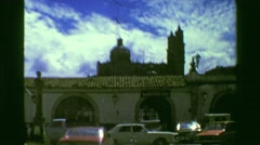 1978: Old city center diving taxi windshield view archway stone buildings. Stock Footage