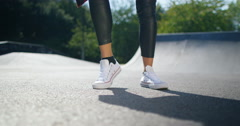 4K Low angle view the feet of young urban street dancer dancing at skate park Stock Footage