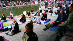 STOCKHOLM, SWEDEN:Crowd of people doing meditation yoga together in public place Stock Footage