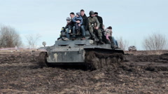 Brave Сivilians Riding From Above On The Tank Through The Fields - stock footage