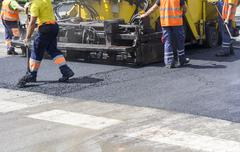 Workers on Asphalting Road Stock Photos
