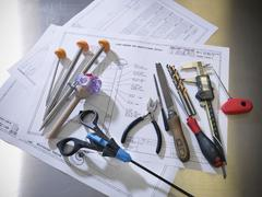 Still life of medical and engineering instruments and tools, arranged on design Kuvituskuvat