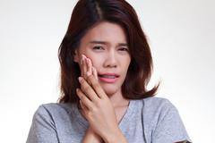 woman toothache - stock photo