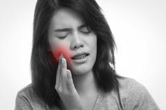 Woman toothache Stock Photos