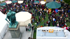 Aerial tracking moving shot of crowd of people walking from top angel with drone - stock footage