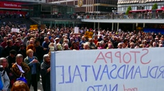 Crowd of people in Anti War Anti Nato No to War demonstrations holding signs Stock Footage