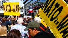 Crowd of people in Anti War Anti Nato No to War demonstrations holding signs - stock footage