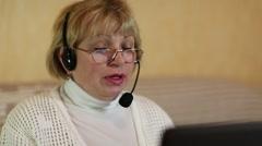 Woman communicates via laptop Stock Footage