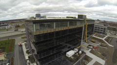 Drone circling around building in construction Stock Footage