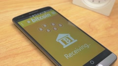 4K Receiving Bitcoin Payment on Smartphone Stock Footage