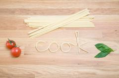 Pasta spelling out the word cook Stock Photos