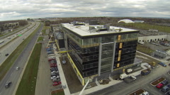 Drone flying by building under construction Stock Footage