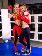 Portrait of two sport girl boxing on ring. - stock photo