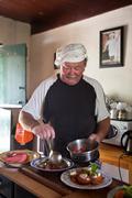 Chef arranging food - stock photo