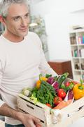 Healthy man with vegetables crate - stock photo