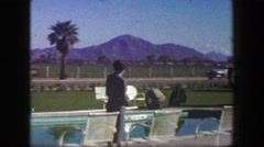 1947: Roadside hotel lounge area desert mountain range country club pool area. Stock Footage