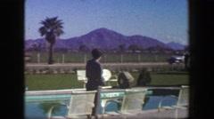 1947: Roadside hotel lounge area desert mountain range country club pool area. - stock footage