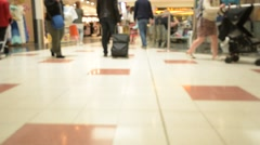 Shoppers In A Busy Airport Departure Lounge Stock Footage