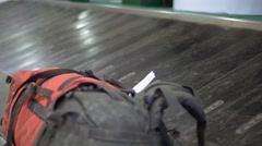 Lost single backpack forgotten on an empty modern luggage belt in the airport Stock Footage