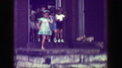 1949: School children leaving class down steep slippery concrete staircase, no - stock footage