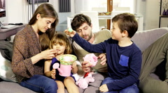 Happy family playing on sofa at home medium shot - stock footage
