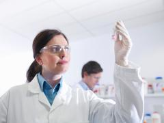 Scientist analysing sample in laboratory Stock Photos
