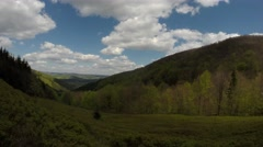 Forest Next to Glade in Mountains Panorama From Right to Left Time Lapse Stock Footage