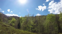 Green Forest Next to Glade in Mountains Panorama From Right to Left Time Lapse Stock Footage