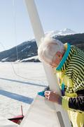 Ice sailor rigging his boat Stock Photos
