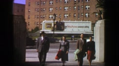 1957: Family walking 50s style advertisement billboard background.  LOS ANGELES, - stock footage