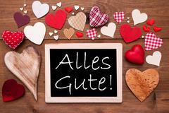 One Chalkbord, Many Red Hearts, Alles Gute Means Best Wishes - stock photo