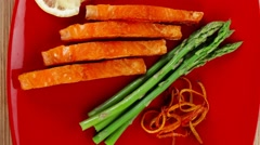 Salmon slices with asparagus lemon fried orange peels Stock Footage